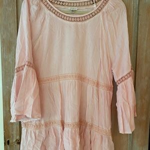 Soft pink tunic with beautiful eyelet detailing